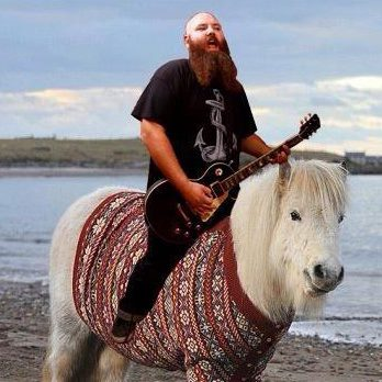 Here's Wade riding a pony.